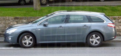Peugeot 508 SW is surprised in a street..